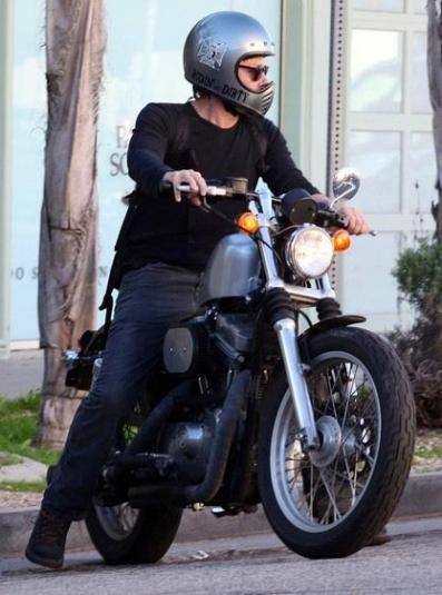 Norman Reedus riding his Harley