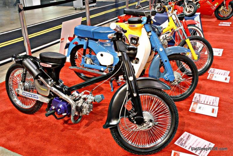 A custom Honda Cub and a few original ones